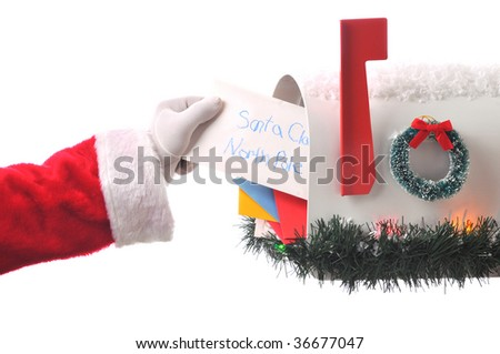 Santa Claus Taking Letter from Mailbox Full of Mail. Horizontal composition, isolated on white hand and arm only. - stock photo
