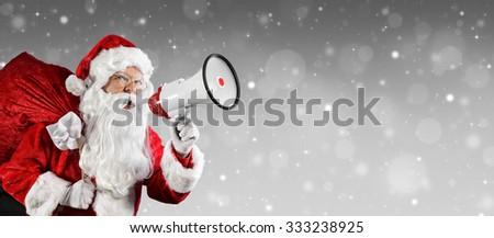 Santa Claus Talking With Megaphone  - stock photo