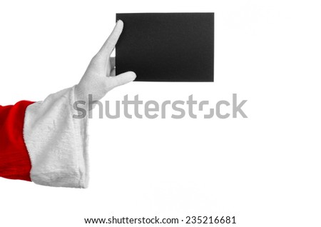 Santa Claus theme: Santa's hand holding a blank black card on a white background - stock photo