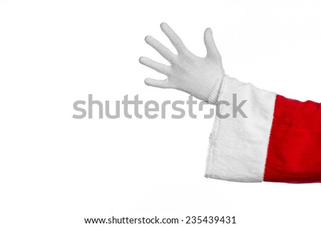 Santa Claus theme: Santa's hand showing gesture on a white background - stock photo