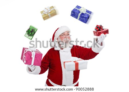 Santa Claus throwing and playing with presents, isolated on white background - stock photo