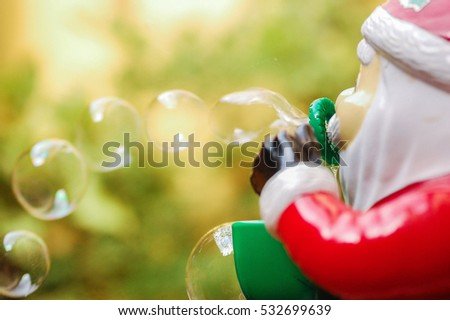 Santa Claus toy blowing soap bubbles