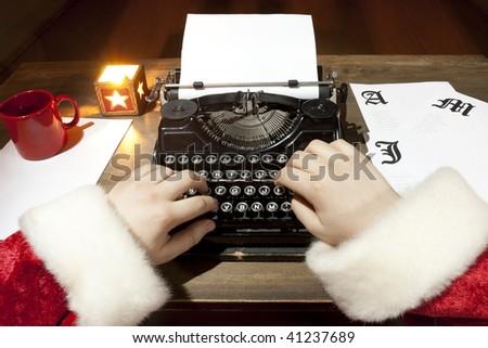 Santa Claus typing on an old typewriter - stock photo