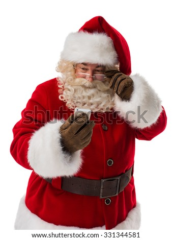 Santa Claus using mobile phone Closeup Portrait. Isolated on White Background - stock photo