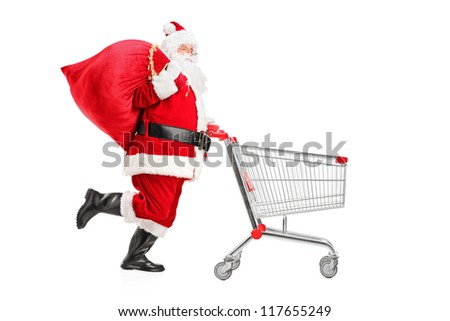 Santa Claus with a bag on his shoulder pushing an empty shopping cart isolated on white background - stock photo