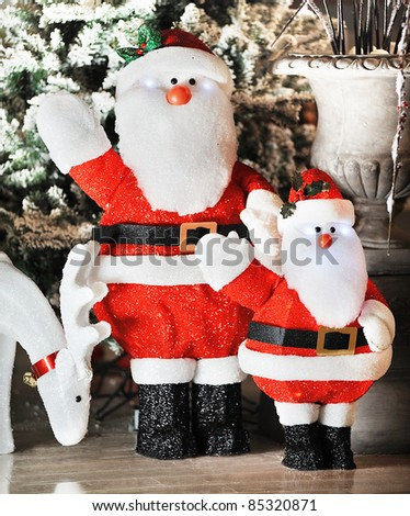 santa claus with a deer in a showroom - stock photo