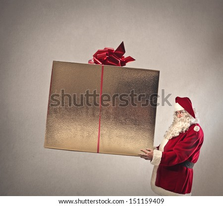 Santa Claus with big gift box in hand - stock photo