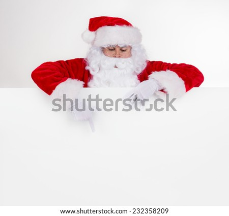 Santa Claus with blank board for text, studio photo