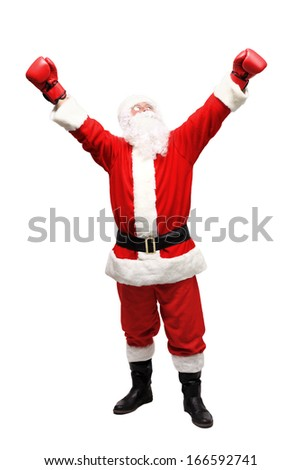 Santa Claus with boxing glove - stock photo