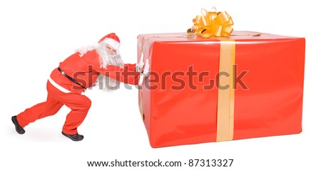 Santa Claus with Christmas box isolated on white background. Funny Santa pushing big Christmas package. Large Xmas surprise with bow.