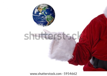 Santa Claus with earth in his white gloved hand - stock photo