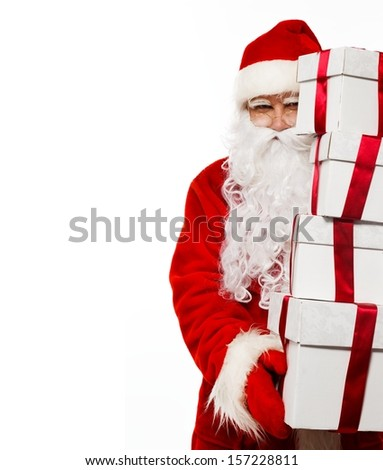 Santa Claus with gift boxes isolated on white background  - stock photo