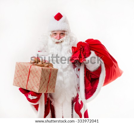Santa Claus with gifts on white background. Isolated - stock photo