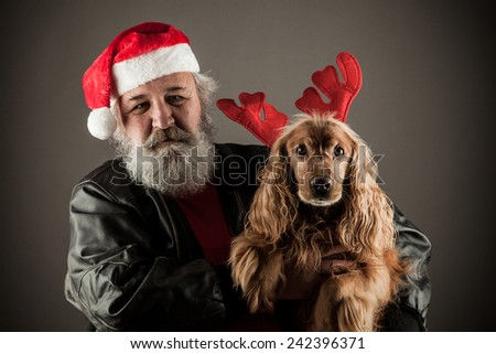 Santa Claus  with his dog as Rudolph the Reindeer - stock photo