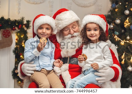 santa claus with kids indoors christmas celebration concept - Santa Claus With Kids