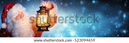 Santa Claus With Lantern In Snowy Night