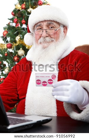 Santa Claus with laptop and  credit card,  buying on-line, isolated on white background - stock photo