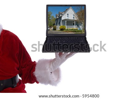 Santa Claus with laptop with a photo of a house on screen in his white gloved hand - stock photo