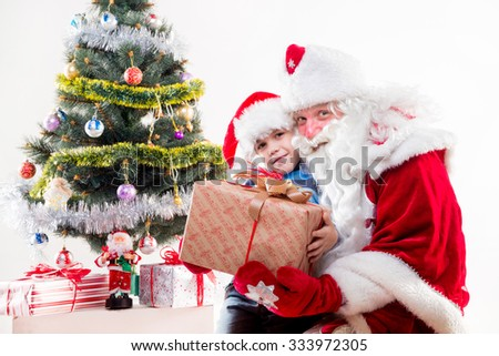 Santa Claus with little boy on white background. - stock photo