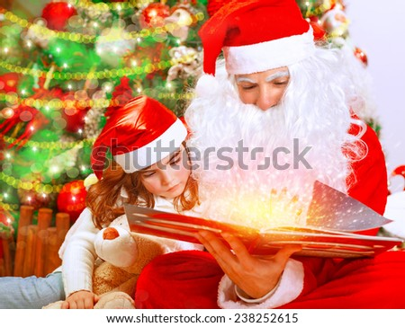 Santa Claus with little granddaughter opening magic book and saw glowing lights, spending Christmas eve near beautiful decorated tree - stock photo