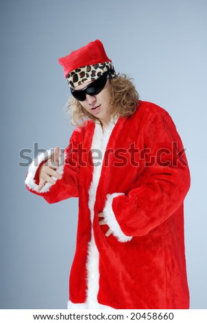 Santa Claus with long hair and sunglasses singing a rap or hip-hop - stock photo