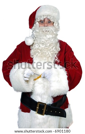 Santa Claus with measure tape over white background - stock photo