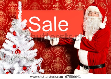 Santa Claus with presents and New Year tree at home. Christmas sale. - stock photo