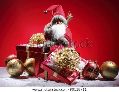 Santa Claus with red giftboxes - stock photo