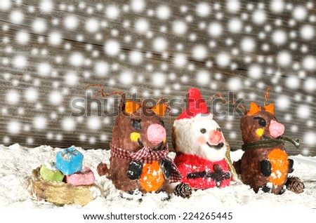Santa claus with reindeers and gifts holiday background - stock photo