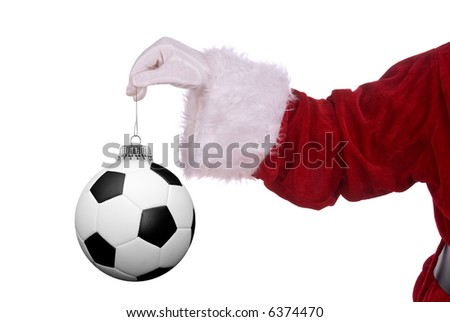Santa Claus with soccer ball ornament in his white gloved hand - stock photo