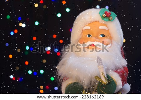 Santa Claus with the snow will bring many gifts to children
