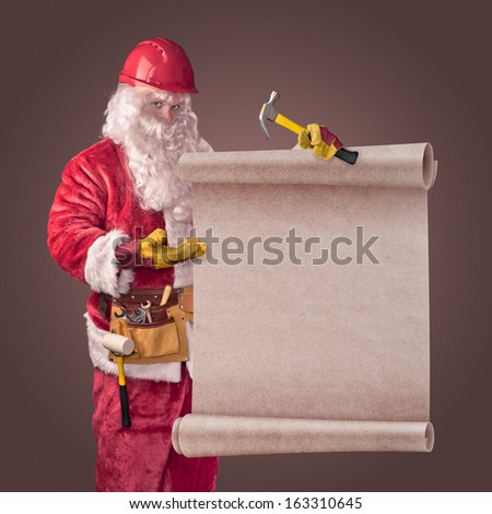 Santa Claus worker in helmet with scroll on brown background - stock photo
