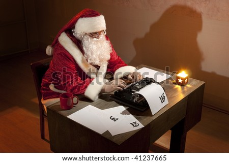 Santa Claus working by the desk, writing on a typewriter