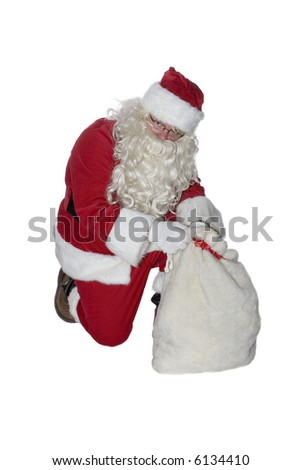Santa Clause isolated on a white background looking in his bag.