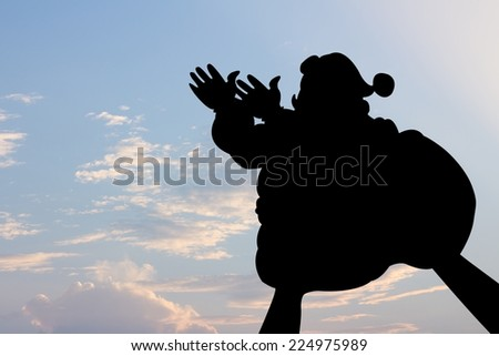 santa clause shape hand silhouette in sky.