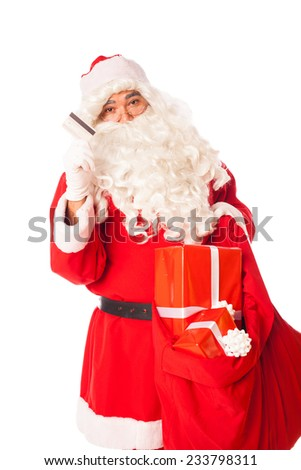 santa clause showing credit card and holding a sack of gifts, on white  - stock photo