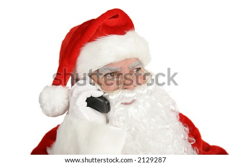 Santa Clause smiles and talks on his cell phone.  Isolated on white. - stock photo