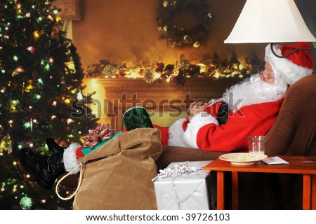 Santa Clause snoozing in a decorated living room with his sack full of gifts by his side. - stock photo