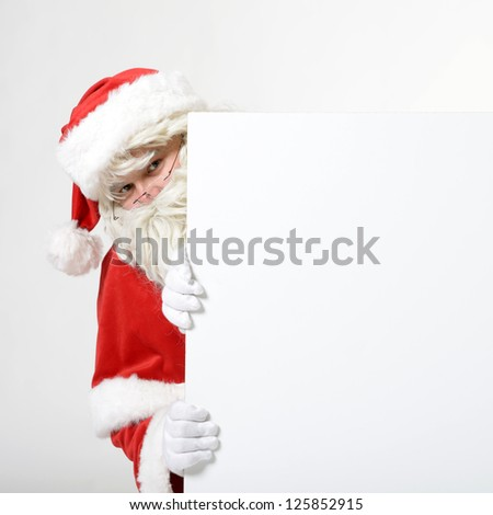 santa clause with empty board - stock photo