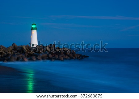 Santa Cruz Breakwater Lighthouse in Santa Cruz, California at night - stock photo