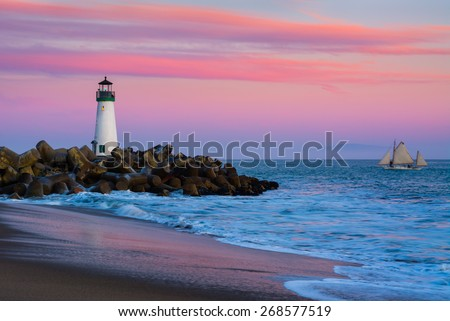 Santa Cruz Breakwater Lighthouse in Santa Cruz, California at sunset - stock photo