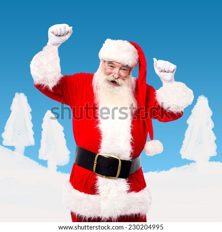 Santa dancing and enjoying his time admist the snow - stock photo