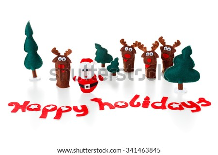 Santa, deer dolls on a shiny surface for christmas, xmas. Concept for family holidays. Isolated white. - stock photo