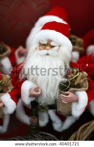 Santa doll with a bag full of presents and a lamp - stock photo