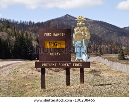 SANTA FE -  APRIL, 12: National Weather Service reports a return of warm, windy fire prone conditions.  Smokey the Bear sign warns visitors about high fire danger on April 12, 2012 in Santa Fe, NM.