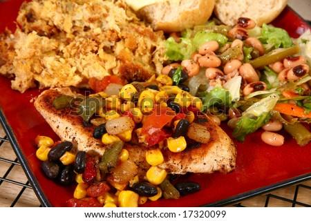 Santa Fe chicken, rolls, baked squash and blackeyed pea salad. - stock photo