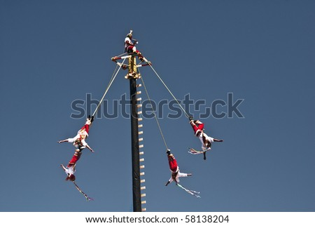 Santa Fe, New Mexico- July 18- Danza de Voladores de Papantla (a Mexican pre-Columbian ariel dance) performed at the annual Viva Mexico festival sponsored by Mexico and Santa Fe on July 18, 2010. - stock photo