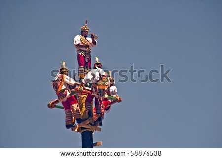 SANTA FE, NEW MEXICO-JULY 18:Danza de Voladores de Papantla (a Mexican pre-Columbian ariel dance) performed at annual Viva Mexico festival sponsored by Mexico and Santa Fe on July 18, 2010 in S. Fe. - stock photo