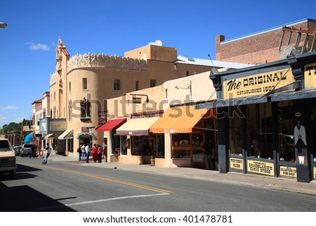 SANTA FE, NEW MEXICO - SEPTEMBER 23: A street containing stores, shops, cafes and art galleries on September 23, 2010 in Santa Fe, New Mexico. The city is known for its Pueblo-style architecture. - stock photo