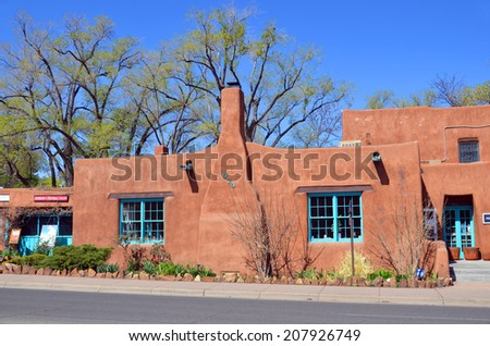 Adobe house stock images royalty free images vectors for Santa fe adobe homes